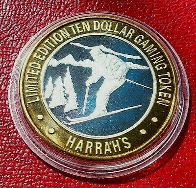 "Harrah's Hotel "" Downhill Skiing "".999 Silver $10 Casino Token in Capsule"