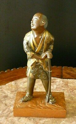 Signed Japanese Late Meiji Gilded Bronze Samurai with Sword on a Wooden Base