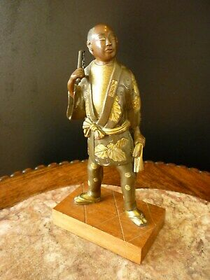 Signed Japanese Late Meiji Gilded Bronze Samurai with Nunchucks on a Wooden Base