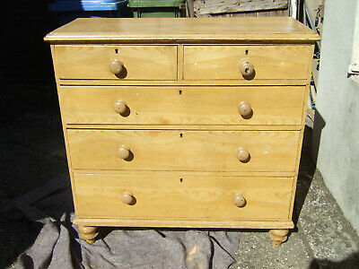 A Victorian pine chest of drawers, original paint scrumble imitating wood grain