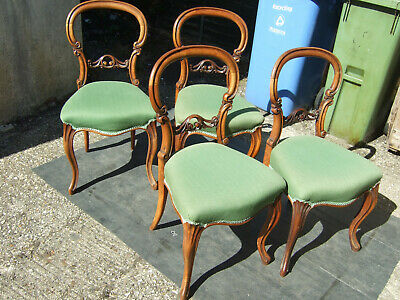 Set of four walnut Victorian balloon back dining chairs.