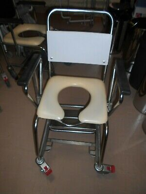 Shower Commode - with wheels and arms - good condition
