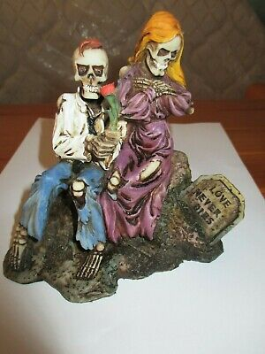 Love Never Dies collectible - clothed skeleton couple sitting on a rock figure
