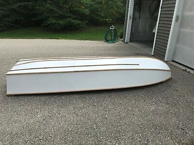 vintage wooden rowboat, white, roughly 12 feet, used but refinished