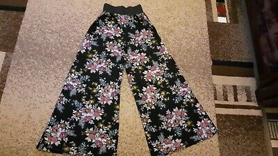 Wide leg trousers generous size 10. In excellent conditions. Worn once