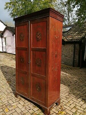 A beautiful oil paint floral hand decorated Victorian wardrobe armoire.