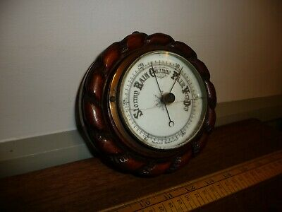 Antique Edwardian period Aneroid Barometer with carved Oak Case .15 cm across