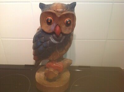 A Large Hand Carved And Painted Wooden Owl On A Perch
