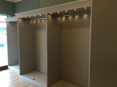Retail display units with dress rails.