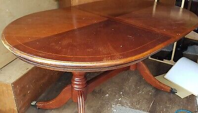 Superb antique solid mahogany oval dining table with carved ball and claw feet
