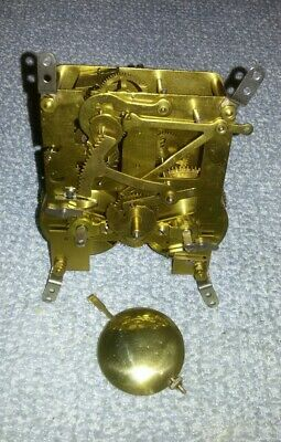 Perivale Antique clock movement complete with pendulum (working)