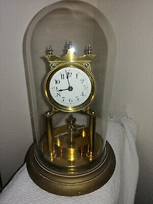 Philip Hauck Anniversary Clock in Glass Dome With Disc Pendulum, Serial 40769.