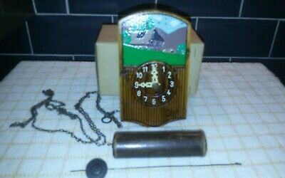 Antique mechanical wall clock/cuckoo clock style (working)