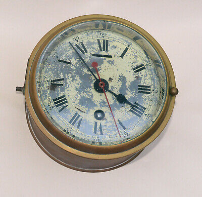 Old brass cased 'Smiths Astral' GPO clock with gimbal mounts