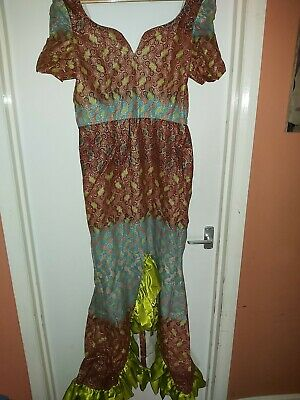 African dress size 14, Made for a wedding close fitting. Look superb on.