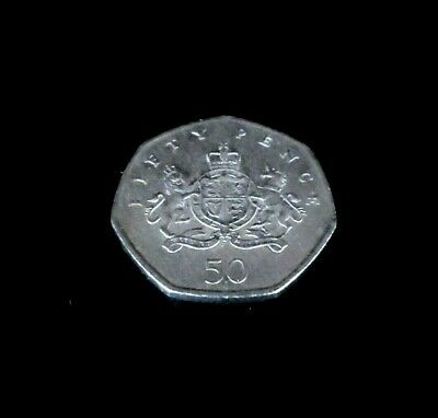 A 2013 Christopher Ironside 100th Anniversary Coat of Arms 50p Collectable Coin.