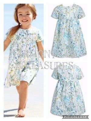 BNWT Girls NEXT FLORAL/MEADOW FLOWERS PRINTED DRESS. AGE 4/5 YEARS