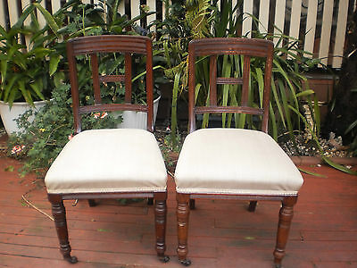 Pair Of Antique / Vintage Solid Hardwood  Timber Chairs With Castor Wheels