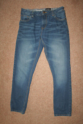 Boy's faded blue jeans by Next. Size 13 yrs to fit height up to 158cm. Pre-loved