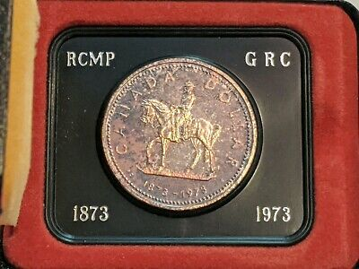 1973 Canada $1 Silver Dollar RCMP Uncirculated. Beautiful Toning. In case.