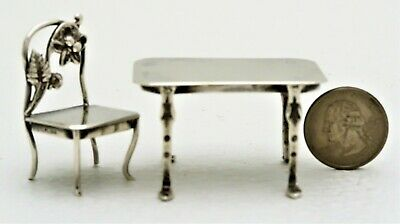 Detailed Sterling Silver Miniature Table and Chair marked Sterling