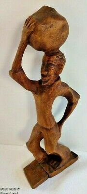 Hand-crafted wooden figure of a water carrier. Beautiful very primitive carving