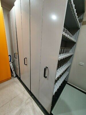 Compactor Shelving for Office. 3.5 sections with adjustable shelves and dividers