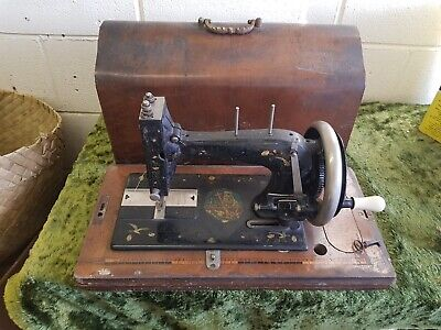 Antique Vintage sewing machine with lockable case and key