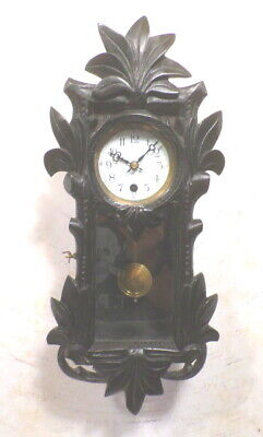 Elaborately Carved Serpentine Vienna Regulator Timepiece