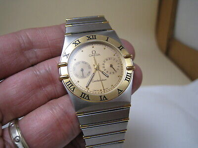 OMEGA  CONSTELLATION  DATE / DAY 18 k GOLD STAINLESS STEEL QUARTZ WATCH