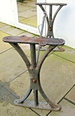 Pair of old reclaim antique Industrial cast iron machinist table bench ends