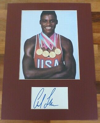 CARL LEWIS-A Hand Signed Card is Presented With A Photo-Mounted & Matted,COA