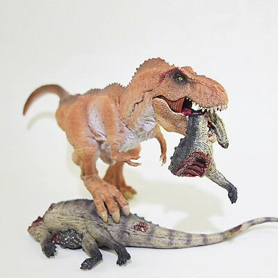 Tyrannosaurus T-Rex action figure toy model eating prey pose Jurassic park