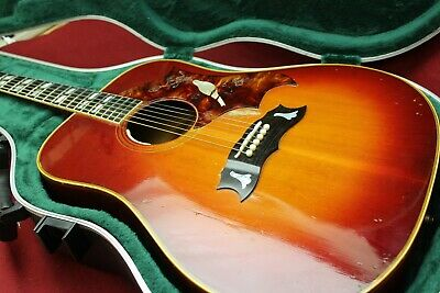 Vintage Gibson Acoustic Guitar with Fender Gig Case