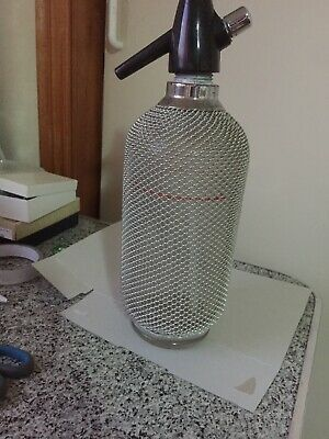 Soda syphon bottle with wire mesh around the glass. Needs New Top To Work 1970s