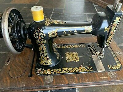 Vintage A.N.A Sewing Machine (missing metal plate) - has various attachments