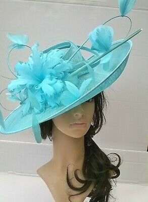 Turquoise Hatinator..Statement with bow & loops Wedding.races.,ascot