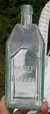 Golden Bitters Geo. C. Hubbel & Co. semi-cabin aqua bitters bottle