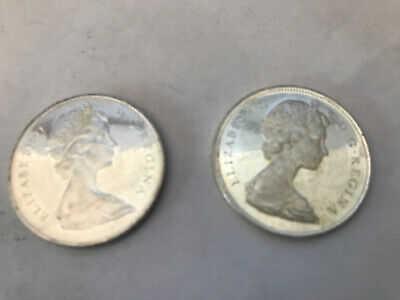 Lot of 2 - 1965 Canadain Silver Dollars - 80% Silver - 0.6 ASW each (1.2 total)