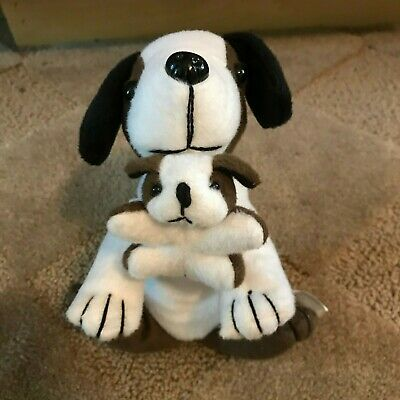 """7"""" brown and white dog holding baby puppy in its mouth, excellent condtion"""
