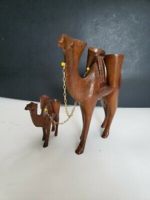 Vintage wood carved camel figure's with 2 buckets-baskets on each camel.