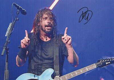 A fantastic 12x8 Autographed Photo of Dave Grohl & CoA