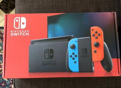 Nintendo Switch 32GB Gray Console with Neon Red and Neon Blue Joy-Con In Hand