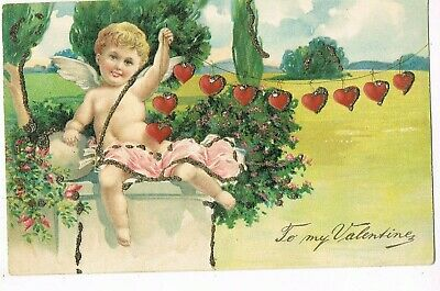 ANTIQUE EMBOSSED VALENTINE Postcard    CUPID RAISING IN AIR HEARTS ON STRING