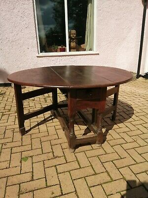 A mid 18th century antique gateleg oak dining table 6 seater
