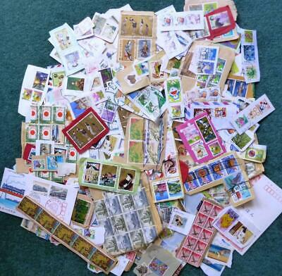 Japan kiloware 225 grams on and off-paper stamps.