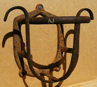 Antique - Cast Iron Rusty Wall Holder from a stable with 2930 on the back