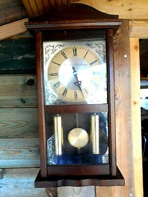 Wooden case pendulum wall clock Vintage look. The London Clock Company, Working