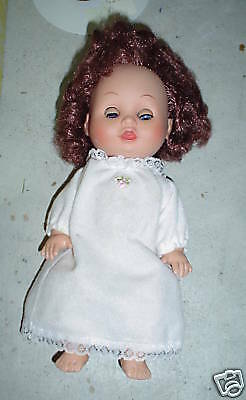 Vinyl and Plastic Red Hed Girl Doll Rabbit Mark LOOK