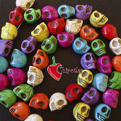 Offerta 23 PERLE TESCHIO colorate 18x14 mm aulite sintet. HALLOWEEN skull beads